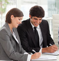 Two colleagues studying sales report Royalty Free Stock Photo