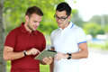 Two college students looking an information using tablet Royalty Free Stock Photo