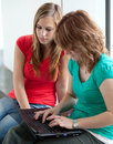 Two college students studying/working Royalty Free Stock Image
