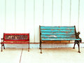 Two colorful benches old empty wooden Royalty Free Stock Image