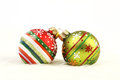 Two colorful Christmas balls on white fur background Royalty Free Stock Photo