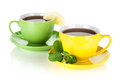 Two colorful cups of tea with lemon and mint Stock Photography