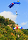 Two colorful skydiving base jumpers each with a very parachutes floating down after leaping from the new river gorge bridge during Royalty Free Stock Image