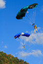 Two colorful skydiving base jumpers floating each with a very parachutes down after leaping from the new river gorge bridge during Stock Images