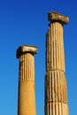 Two columns in ephesus lit by the evening sun over the blue sky turkey Royalty Free Stock Photos