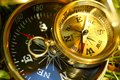 Two compasses on grass Royalty Free Stock Photo