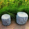 Two concrete chairs in garden chillout tree grass Royalty Free Stock Photo