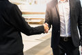 stock image of  Two confident business man shaking hands for demonstrating their agreement to sign agreement or contract between their commpany