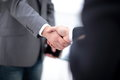 Two confident business man shaking hands during a meeting in office, success, dealing, greeting and partner concept. Royalty Free Stock Photo