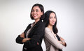 Two confident female professionals posing Royalty Free Stock Photo