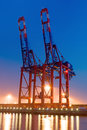 Two container cranes in hamburg at night Royalty Free Stock Photos