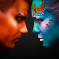 Two contrasts fire and water the photo in a profile of the men the woman body art Stock Image