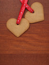 Two cookie hearts for valentines day on a table Royalty Free Stock Photo