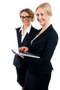 Two corporate women working on laptop Royalty Free Stock Photos