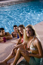 Two couples hanging out in swimming pool Stock Images