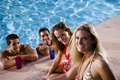 Two couples hanging out in swimming pool Royalty Free Stock Photography