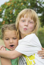 Two cousins ​​in a common embrace Royalty Free Stock Photo