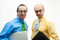 Two crazy businessman laptops Royalty Free Stock Photo