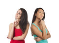 Two creative girls thinking women pose isolated on white background Stock Photography