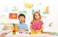 Two creative kids three years old sitting by the table with paints and brushes Royalty Free Stock Photo