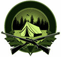 Two crossed guns with the campus tent and forest on background, vector logo.