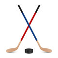 Two crossed hockey sticks and puck. Royalty Free Stock Photo