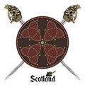 Two crossed Scottish Highland backsword and Scottish battle shield decorated with studs in the Celtic style