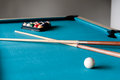 Two cue and balls on the table for billiard a blue billiards Stock Photo