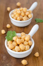 Two cups of boiled chickpeas Royalty Free Stock Image