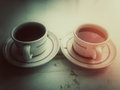 Two cups of coffee image a different use color and light to show the difference Stock Photos