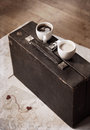 Two cups of coffee and old suitcase artwork in vintage style Stock Photos