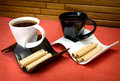 Two cups of coffee and wafer sticks with chocolate Royalty Free Stock Photo
