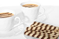 Two cups of coffee with waffle cream puff. Royalty Free Stock Photo