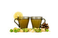 Two cups of green tea with lemon fir cone and physalis on white background Royalty Free Stock Image