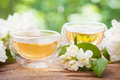 Two cups of healthy jasmine tea. Royalty Free Stock Photo