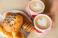 Two cups of latte with heart and cakes Royalty Free Stock Photo