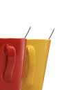 Two cups with spoon red yellow Stock Photos