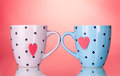 Two cups and tea bags with red heart-shaped label Royalty Free Stock Image