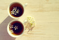 Two cups of tea and spring flowers Royalty Free Stock Photo