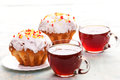 Two cups tea two muffins plates Royalty Free Stock Images