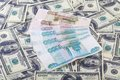 Two currencies us dollars and roubles russian bills laying over background Royalty Free Stock Images