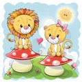 Two Cute Cartoon lions on mushrooms Royalty Free Stock Photo