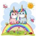 Two Cartoon Unicorns are sitting on the rainbow