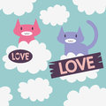Two cute cats in love on the clouds Stock Photo