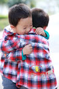 Two cute little boys hugging Royalty Free Stock Photo
