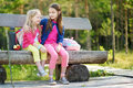Two cute little sisters having fun during forest hike on beautiful summer day Royalty Free Stock Photo