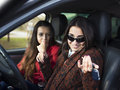 Two cute young smiling girl sitting in a car Royalty Free Stock Photo