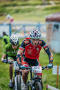 Two cyclists compete sludorudnik russia august during spartakiada among boys and girls in cycling mountain bike sludorudnik russia Stock Images
