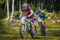 Two cyclists compete sludorudnik russia august during spartakiada among boys and girls in cycling mountain bike sludorudnik russia Stock Image