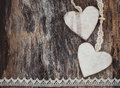 Two decorative hearts on aged wooden background. Valentine Day concept.
